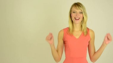 Young attractive woman rejoices - studio — Stock Video