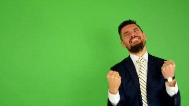 Business man rejoices (joy) - green screen - studio — Stock Video