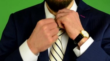 Business man adjusts his tie - green screen - studio - closeup — Stock Video