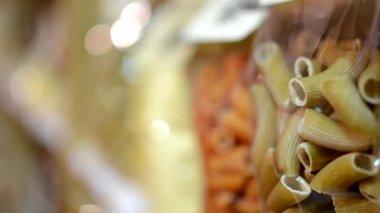 Pasta in bags (penne) in shelf — Stock Video