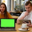 Woman phone and man works on tablet in cafe - coffee and cake - computer green screen (notebook) — Stock Video #59945681