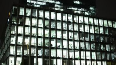 Business buildings (offices) - night - windows with lights - city — Stockvideo