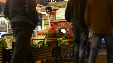 Restaurant (vintage tram)  - outdoor seating - people walking — Stock Video