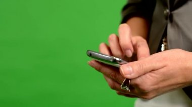 Business woman works on phone - green screen - studio - closeup — Стоковое видео