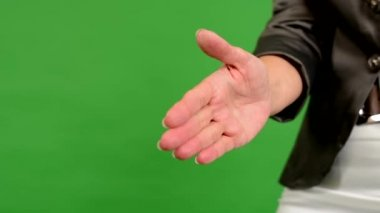 Business middle aged woman gives a hand in greeting - green screen - studio - closeup — Stock Video