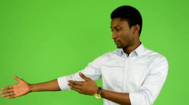 Young handsome black man introduce - green screen - studio — Stock Video