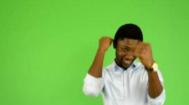 Young handsome black man rejoices - green screen - studio — Stock Video