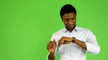 Young handsome black man oversleep and confused - green screen - studio — Stock Video