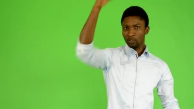 Young handsome black man protests - green screen - studio — Stock Video