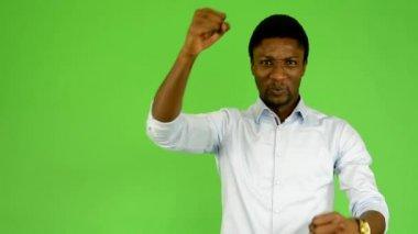 Young handsome black man chants - green screen - studio — Stock Video