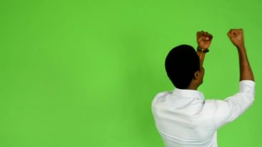 Young handsome black man rejoices (back) - green screen - studio — 图库视频影像