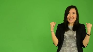Young attractive asian woman rejoices - green screen studio — Stock Video