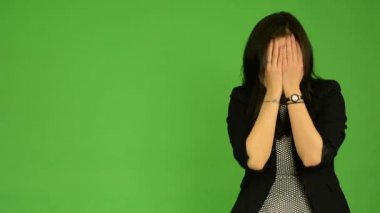 Young attractive asian woman cries - green screen studio — Stock Video