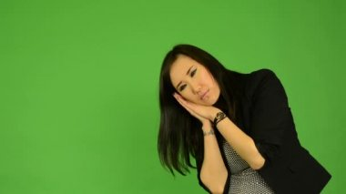 Young attractive asian woman oversleep and confused  - green screen studio — Stock Video