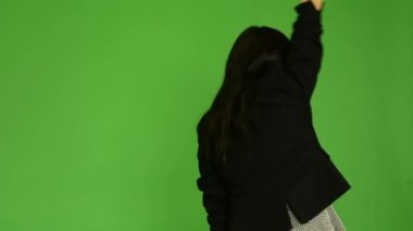 Young attractive asian woman rejoices (back) - green screen studio — Stock Video