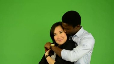 Happy couple dance - black man and asian woman - green screen studio — Stock Video