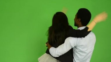 Happy couple rejoice - black man and asian woman - green screen studio — Stock Video