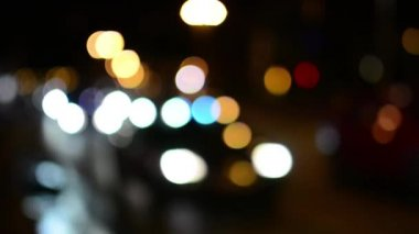 Night city - night street with cars - lamps - car headlight - soft blurred — Stock Video