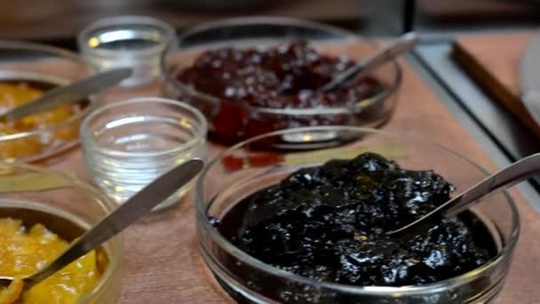 Table with food - buffet - marmalade (jam) — Vídeo de stock
