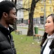 The couple shake hands - black man shake hands with asian woman - urban city with cars - city — Stock Video #67499959