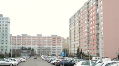 Housing estate (high rise block of flats) with nature and car park - people — Stock Video