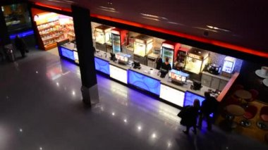 Snack bar in the cinema with people and lobby in the cinema - shot from above — Stock Video