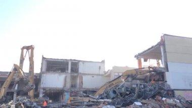 Demolition of buildings - crane - worker — Vídeo de stock