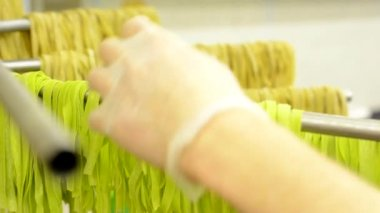 Chef puts dry pasta on stand  - after production - closeup — Stock Video