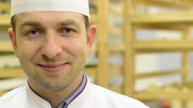 Chef smiles to camera - closeup — Stock Video