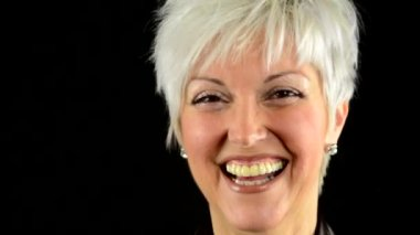 Business middle aged woman laughs - black background - studio - detail (closeup) — Stock Video