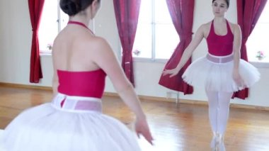 Young ballerina dancing in the hall - floor - reflection in the mirror — Stock Video