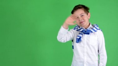 Young handsome child boy waves with hand - green screen - studio — Stock Video