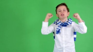 Young handsome child boy rejoices - green screen - studio — Stock Video