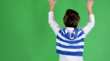 Young handsome child boy rejoices (boy stands back) - green screen - studio — Stock Video