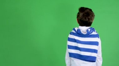 Young handsome child boy looks around the surroundings (boy stands back) - green screen - studio — Stock Video