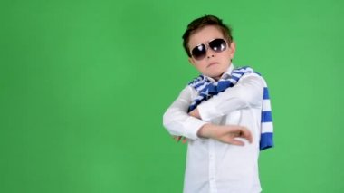 Young handsome child boy posing with sunglasses - green screen - studio — 图库视频影像
