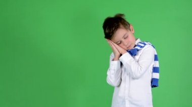 Young handsome child boy wakes up and is surprised  - green screen - studio — Video Stock