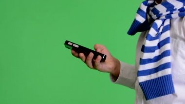 Young child boy works on mobile phone - green screen - closeup - studio — ストックビデオ