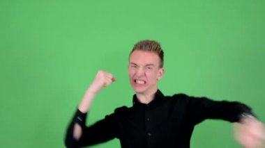 Young handsome man studio rejoices - green screen — Stock Video