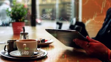 Woman works on tablet in cafe - financial market (exchange) - graph - closeup — Stock Video