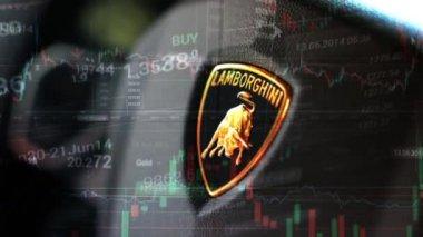 PRAGUE, CZECH REPUBLIC, CAR EXHIBITION - SEPTEMBER 27, 2014: detail of logo (wheel) - Lamborghini (interior) - financial market (exchange) - graph — Stock Video