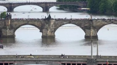 Prague - Charles bridge with walking people and other bridges - Vltava river — Stock Video