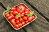 Tomatoes In A Wooden Bowl On Floorboards — 图库照片