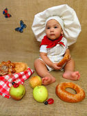 Baby boy dressed as a baker — Stock Photo
