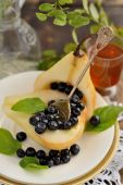 Pear with blueberries and honey — Stock Photo