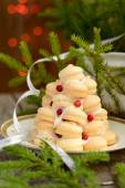 Small Christmas tree of homemade cookies with fir branches — Stock Photo