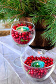 Candles in glasses with cranberries — Stock Photo