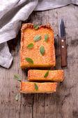 Homemade orange tart with mint on wooden background — Zdjęcie stockowe