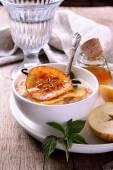 Vanilla porridge of oatmeal with honey caramel apples slices — Stock Photo