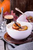 Rice pudding with caramel vanilla plums — Stock Photo